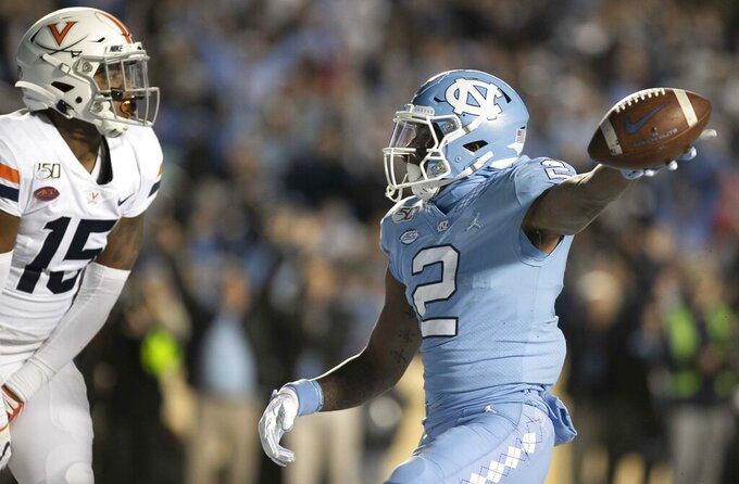 North Carolina's Dyami Brown (2) reacts after scoring on a 34-yard pass from quarterback Sam Howell against Virginia during the second quarter of an NCAA college football game Saturday, Nov. 2, 2019, in Chapel Hill, N.C. (Robert Willett/The News & Observer via AP)