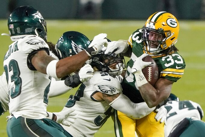 Green Bay Packers' Aaron Jones runs during the second half of an NFL football game against the Philadelphia Eagles Sunday, Dec. 6, 2020, in Green Bay, Wis. (AP Photo/Morry Gash)