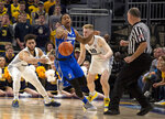 Creighton Ty-Shon Alexander, center, steals the ball from Marquette guard Markus Howard, left, during the second half of an NCAA college basketball game Sunday, March 3, 2019, in Milwaukee. (AP Photo/Darren Hauck)