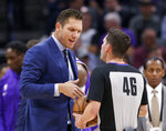 Sacramento Kings coach Luke Walton, talks with referee Ben Taylor at the end of the first quarter of the team's NBA basketball game against the Charlotte Hornets in Sacramento, Calif., Wednesday, Oct. 30, 2019. (AP Photo/Rich Pedroncelli)
