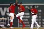 Boston Red Sox's Xander Bogaerts (2), Mookie Betts, center, and Jackie Bradley Jr., right, celebrate after defeating the Baltimore Orioles in a baseball game in Boston, Saturday, Aug. 17, 2019. (AP Photo/Michael Dwyer)