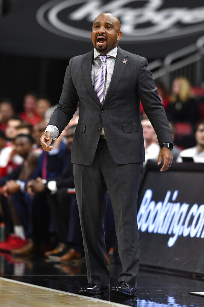 Miami (Ohio) coach Jack Owens shouts instructions to his team during the second half of an NCAA college basketball game against Louisville in Louisville, Ky., Wednesday, Dec. 18, 2019. Louisville won 70-46. (AP Photo/Timothy D. Easley)