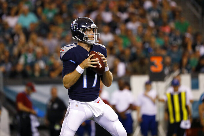 Tennessee Titans' Ryan Tannehill looks to pass during the first half of the team's preseason NFL football game against the Philadelphia Eagles, Thursday, Aug. 8, 2019, in Philadelphia. (AP Photo/Matt Rourke)