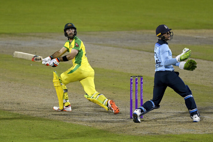 Australia's Glenn Maxwell, left, bats during the third ODI cricket match between England and Australia, at Old Trafford in Manchester, England, Wednesday, Sept. 16, 2020. (Shaun Botterill/Pool via AP)