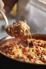 This image shows a recipe for one skillet cheesy beefy macaroni. More people are cooking at home these days, and when they do eat restaurant food, they're often looking for comfort food, experts say. Other trends include simpler recipes, recipes with fewer ingredients, one-pot meals, sheet-pan meals, finger food and pantry-ingredient recipes, all up significantly year over year. (Cheyenne M. Cohen/Katie Workman via AP)