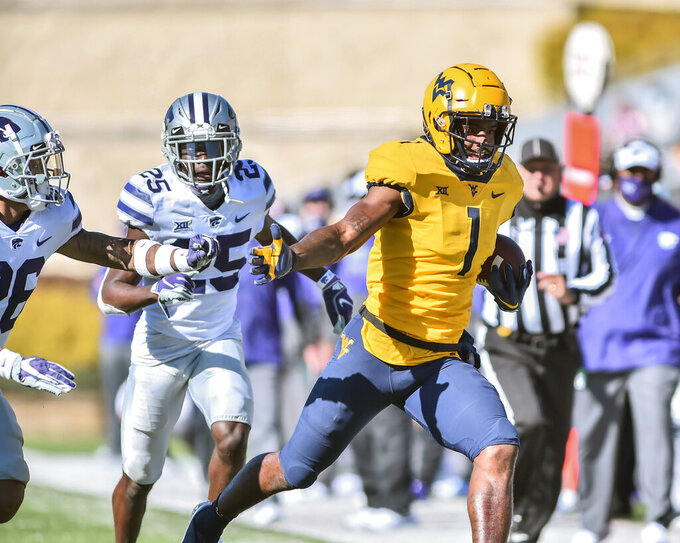 West Virginia wide receiver T.J. Simmons (1) picks up yards after a catch against Kansas State during an NCAA college football game, Saturday, Oct. 31, 2020, in Morgantown, W.Va. (William Wotring/The Dominion-Post via AP)