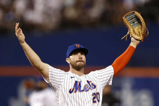 New York Mets first baseman Pete Alonso gestures to the crowd during the ninth inning of the team's baseball game against the Toronto Blue Jays on Friday, July 23, 2021, in New York. The Mets won 3-0. (AP Photo/Adam Hunger)