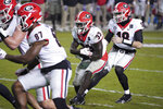Georgia running back Daijun Edwards (33) takes a handoff from JT Daniels (18) during the second half of the team's NCAA college football game against South Carolina on Saturday, Nov. 28, 2020, in Columbia, S.C. Georgia won 45-16. (AP Photo/Sean Rayford)