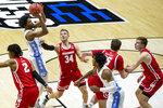 North Carolina's Kerwin Walton, second from left, shoots between Wisconsin's Aleem Ford (2) and Brad Davison (34) during the first half of a first-round game in the NCAA men's college basketball tournament, Friday, March 19, 2021, at Mackey Arena in West Lafayette, Ind. (AP Photo/Robert Franklin)