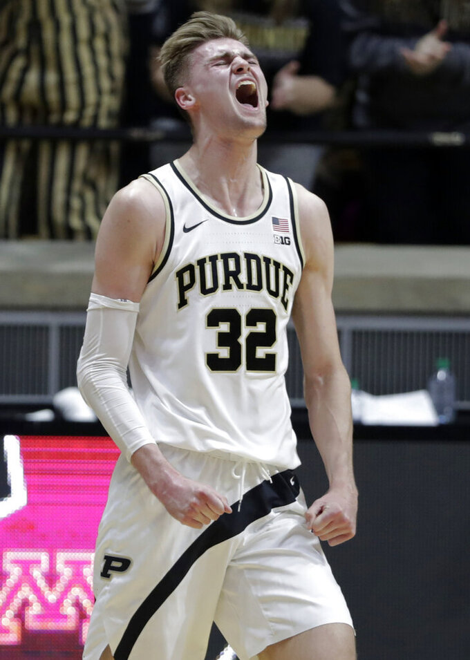 Purdue center Matt Haarms (32) celebrates during the second half of an NCAA college basketball game against Minnesota in West Lafayette, Ind., Sunday, Feb. 3, 2019. (AP Photo/Michael Conroy)