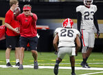 Georgia head coach Kirby Smart runs a drill as defensive back Tyrique McGhee (26) lines up at the Superdome in New Orleans, Friday, Dec. 28, 2018. Georgia will face Texas in the Sugar Bowl NCAA college football game on Jan. 1, 2019. (AP Photo/Gerald Herbert)