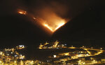 A wildfire burns on Casitagua hill, north of Quito, Ecuador, Wednesday, Jan. 15, 2020. While the fire is not threatening homes, the smoke is reaching the north of Quito. (AP Photos/Dolores Ochoa)