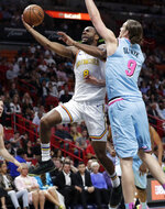 Golden State Warriors guard Alec Burks (8) goes to the basket as Miami Heat forward Kelly Olynyk (9) defends during the first half of an NBA basketball game, Friday, Nov. 29, 2019, in Miami. (AP Photo/Lynne Sladky)