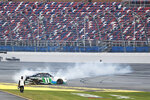 Justin Haley (11) does a burnout in front of empty seats after winning a NASCAR Xfinity auto race at Talladega Superspeedway in Talladega Ala., Saturday, June 20, 2020. (AP Photo/John Bazemore)