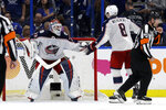 Columbus Blue Jackets goaltender Sergei Bobrovsky (72) celebrates with defenseman Zach Werenski (8) after the Blue Jackets defeated the Tampa Bay Lightning 4-3 during Game 1 of an NHL Eastern Conference first-round hockey playoff series Wednesday, April 10, 2019, in Tampa, Fla. (AP Photo/Chris O'Meara)