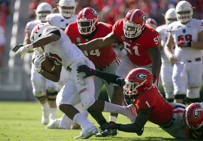 FILE - In this Sept. 1, 2018, file photo, Georgia's Brenton Cox (1), David Marshall (51) and Michael Barnett (94) tackle Austin Peay running back Ahmaad Tanner (21) during an NCAA college football game in Athens, Ga. Georgia's stifling defense will face its toughest challenge so far in trying to stop quarterback Drew Lock and the Missouri Tigers on Saturday. (Jenn Finch/Athens Banner-Herald via AP, File)