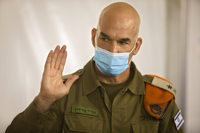 "Maj. Gen. Ori Gordin, head of the Israeli army's Home Front Command, gestures as he speaks at its headquarters, in Ramle, Central Israel, Tuesday, Aug. 25, 2020. Gordin is overseeing the military's coronavirus ""task force,"" formed in August to bring one of the developed world's worst outbreaks under control. Its main responsibility is taking the lead in contact tracing and breaking chains of infection. (AP Photo/Sebastian Scheiner)"