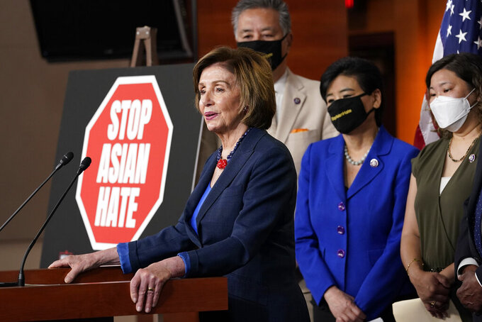 House Speaker Nancy Pelosi of Calif., left, speaks during a news conference on Capitol Hill in Washington, Tuesday, May 18, 2021, on the COVID-19 Hate Crimes Act. Pelosi is joined by Rep. Mark Takano, D-Calif., second from left, Rep. Judy Chu, D-Calif., second from right and Rep. Grace Meng, D-N.Y. (AP Photo/Susan Walsh)