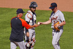 Detroit Tigers relief pitcher Kyle Funkhouser, right, hands the ball to manager A.J. Hinch, left, as catcher Eric Haase looks on during a pitching change in the seventh inning of a baseball game against the Pittsburgh Pirates in Pittsburgh, Monday, Sept. 6, 2021. (AP Photo/Gene J. Puskar)