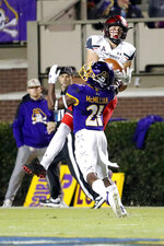 East Carolina's Ja'Quan McMillian (21) breaks up a pass to Cincinnati's Trent Cloud, top, during the first half of an NCAA college football game in Greenville, N.C., Saturday, Nov. 2, 2019. (AP Photo/Karl B DeBlaker)