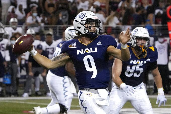 Northern Arizona quarterback Jeff Widener throws down field against Arizona in the first half of an NCAA college football game, Saturday, Sept. 18, 2021, in Tucson, Ariz. (AP Photo/Rick Scuteri)