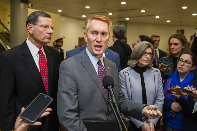 James Lankford, R-Okla., with Sen. John Barrasso, R-Wyo., left, and Sen. Joni Ernst, R-Iowa, speaks to reporters on Capitol Hill in Washington, Saturday, Jan. 25, 2020. (AP Photo/Manuel Balce Ceneta)