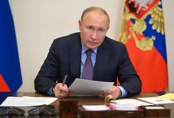 Russian President Vladimir Putin attends a meeting with members of Russian Government and heads of United Russia party via videoconference at the Novo-Ogaryovo residence outside Moscow, Russia, Tuesday, Sept. 14, 2021. Putin entered self-isolation after people in his inner circle became infected with the coronavirus, the Kremlin said Tuesday, adding that the leader himself tested negative for COVID-19. (Alexei Druzhinin, Sputnik, Kremlin Pool Photo via AP)