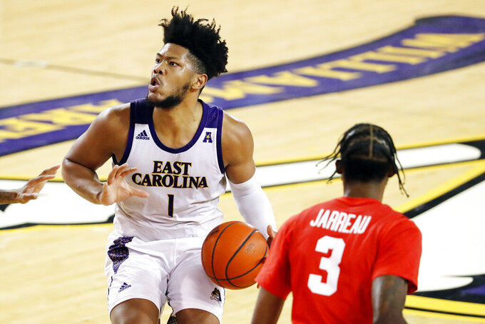 East Carolina's Jayden Gardner (1) prepares to shoot the ball with Houston's DeJon Jarreau (3) nearby during the second half of an NCAA college basketball game in Greenville, N.C., Wednesday, Feb. 3, 2021. (AP Photo/Karl B DeBlaker)