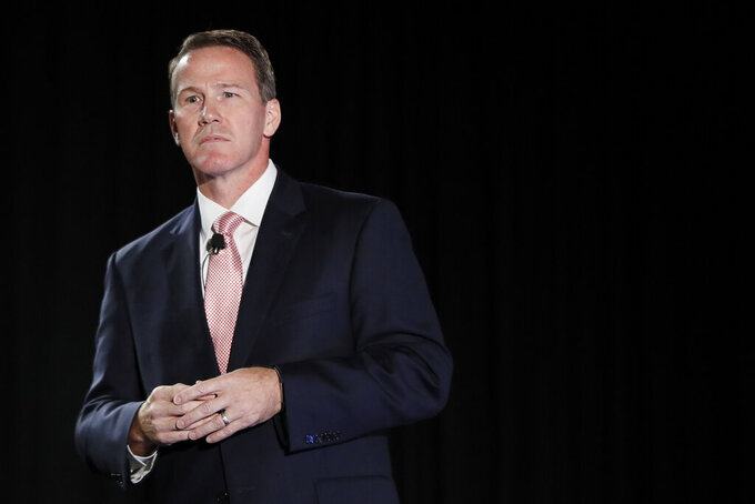 FILE - In this Oct. 16, 2018, file photo, Jon Husted, then a candidate for Ohio Lt. Governor, speaks at the Columbus Chamber of Commerce Government Day, in Cincinnati, Ohio. Now the current Ohio lieutenant governor, Husted entered the coronavirus pandemic as one of Ohio's rising Republican stars. Following an uninterrupted two-decade climb from state representative, to House speaker, to state senator, to secretary of state, to lieutenant governor, his next stop was supposed to be the Governor's Residence. But his party's hard turn to the right has required deft recalculation. (AP Photo/John Minchillo, File)