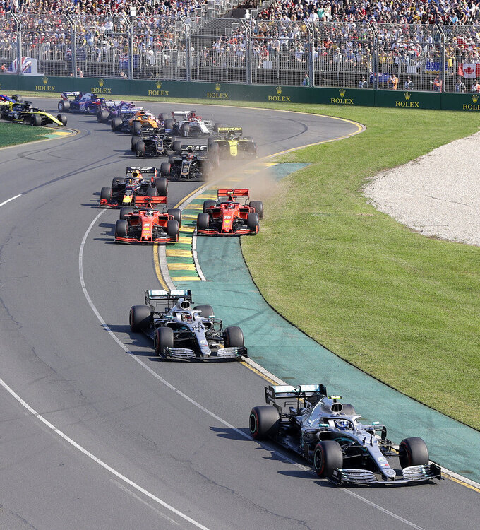 Mercedes driver Valtteri Bottas of Finland, right, leads the pack during the start of the Australian Formula 1 Grand Prix in Melbourne, Australia, Sunday, March 17, 2019. (AP Photo/Rick Rycroft)