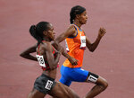 Sifan Hassan, of Netherlands, bronze, leads Faith Kipyegon, of Kenya who won the gold during the final of the women's 1,500-meters at the 2020 Summer Olympics, Friday, Aug. 6, 2021, in Tokyo, Japan. (AP Photo/Francisco Seco)