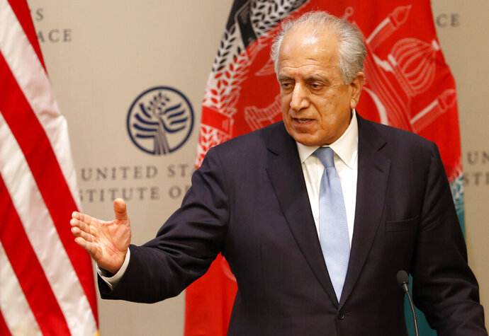 FILE - In this Feb. 8, 2019 file photo, Special Representative for Afghanistan Reconciliation Zalmay Khalilzad speaks on the prospects for peace at the U.S. Institute of Peace, in Washington. Washington's Afghan peace envoy is crisscrossing South Asia and Europe trying to resuscitate efforts to find a negotiated end to Afghanistan's 18 -year war even though President Donald Trump hasn't expressed any interest in resuming talks with the Taliban. (AP Photo/Jacquelyn Martin, File)