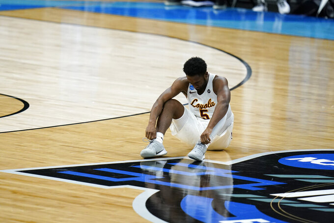 Loyola Chicago guard Keith Clemons sits on the court during the second half of a Sweet 16 game against Oregon State in the NCAA men's college basketball tournament at Bankers Life Fieldhouse, Saturday, March 27, 2021, in Indianapolis. (AP Photo/Jeff Roberson)