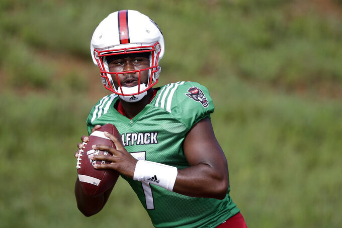 This photo taken Tuesday, Aug. 6, 2019 shows North Carolina State quarterback Matthew McKay during an NCAA college football practice in Raleigh, N.C. (AP Photo/Gerry Broome)