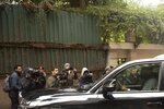 Journalists film a vehicle leaving the house of ex-Nissan chief Carlos Ghosn in Beirut, Lebanon, Friday, Jan. 3, 2020. The former Nissan Motor Co. Chairman fled Japan this week while awaiting trial on financial misconduct charges and appeared in Lebanon. (AP Photo/Maya Alleruzzo)