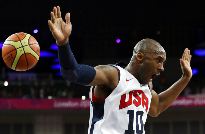 FILE - United States' Kobe Bryant reacts after a dunk during the men's gold medal basketball game against Spain at the 2012 Summer Olympics in London, in this Sunday, Aug. 12, 2012, file photo. Bryant wore No. 24 and No. 8 with the Los Angeles Lakers, but he donned No. 10 for USA Basketball when he helped the Americans capture gold medals at the 2008 and 2012 Olympics. Jayson Tatum has worn that number as part of U.S. teams several times since — and will wear it at the Tokyo Olympics, where the Americans will aim to capture a fourth consecutive gold medal. (AP Photo/Eric Gay, File)