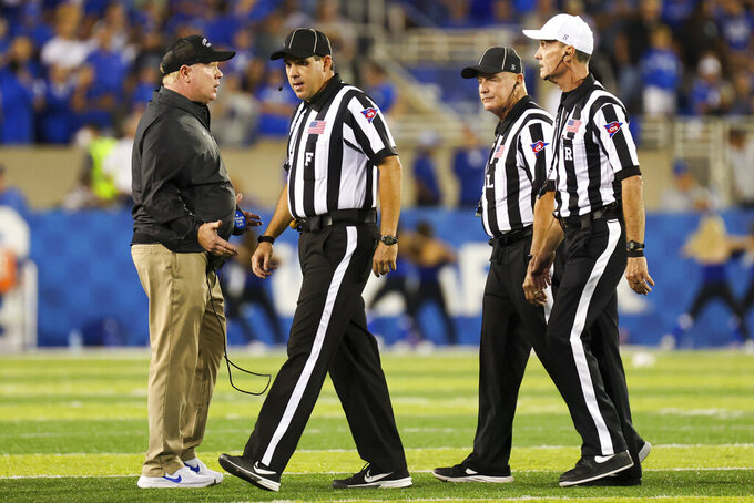 Kentucky coach Mark Stoops argues with officals during the second half of the team's NCAA college football game against Missouri in Lexington, Ky., Saturday, Sept. 11, 2021. (AP Photo/Michael Clubb)