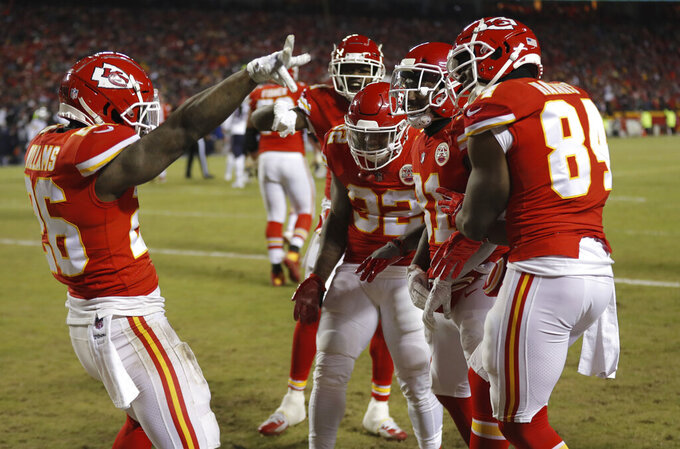 Kansas City Chiefs running back Damien Williams (26) celebrates a touchdown with his teammates during the second half of the AFC Championship NFL football game against the New England Patriots, Sunday, Jan. 20, 2019, in Kansas City, Mo. (AP Photo/Charlie Neibergall)