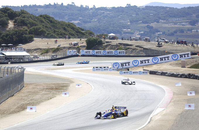 Alexander Rossi exits turn 3 and enters turn 4 Sunday at Laguna Seca.(Elias Funez/The Union via AP)