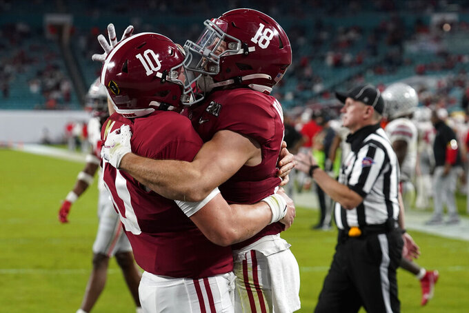 Alabama wide receiver Slade Bolden, right, celebrates after scoring a touchdown with quarterback Mac Jones during the second half of an NCAA College Football Playoff national championship game against Ohio State, Monday, Jan. 11, 2021, in Miami Gardens, Fla. (AP Photo/Chris O'Meara)