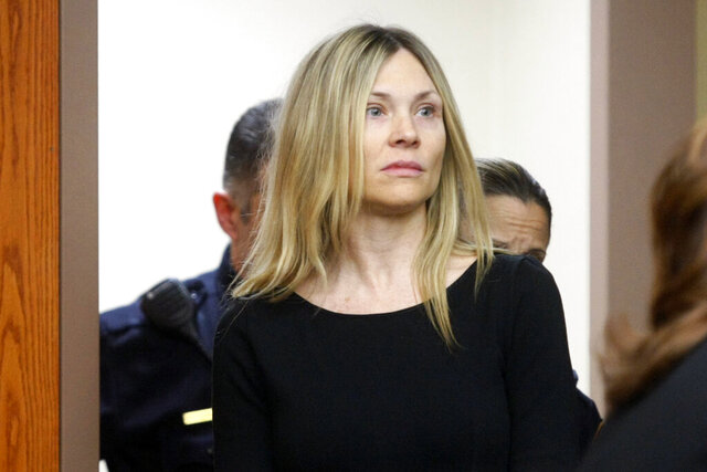 FILE - This Feb. 14, 2013 file photo shows Amy Locane Bovenizer entering the courtroom to be sentenced in Somerville, N.J. On Friday, July 24, 2020, the former