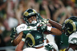 Colorado State wide receiver Dante Wright, back, celebrates his touchdown catch with tight end Trey McBride, front left, and wide receiver Warren Jackson, front right, in the first quarter of an NCAA college football game against Colorado, Friday, Aug. 30, 2019, in Denver. (AP Photo/David Zalubowski)