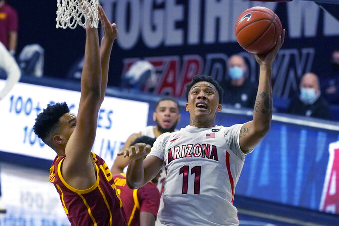 Arizona forward Ira Lee (11) shoots over Southern California forward Isaiah Mobley during the second half of an NCAA college basketball game, Thursday, Jan. 7, 2021, in Tucson, Ariz. (AP Photo/Rick Scuteri)