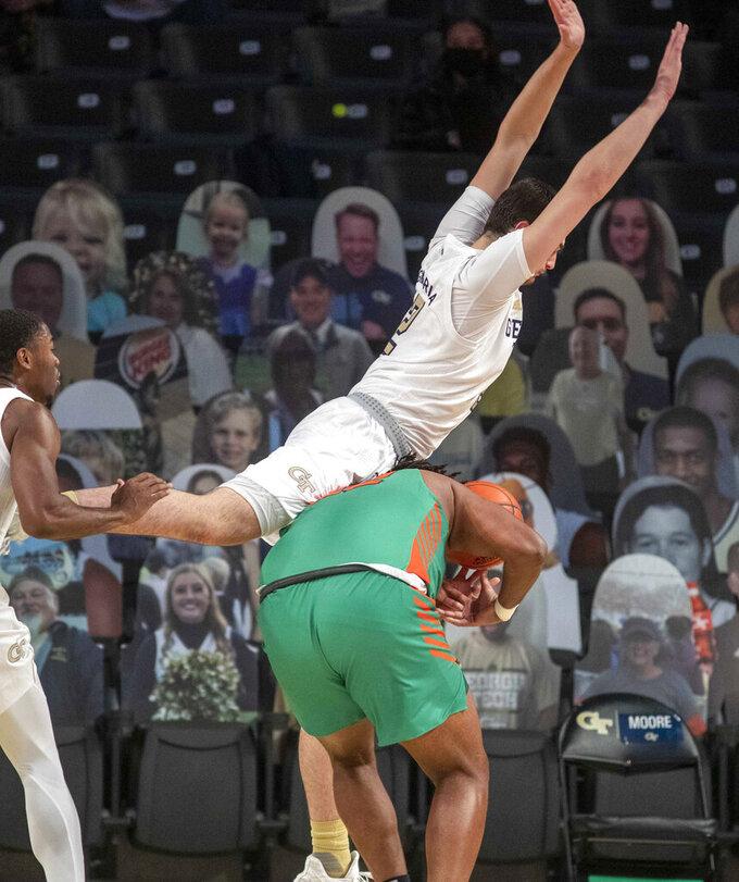 Georgia Tech forward Saba Gigiberia (2) fowls Florida A&M center Evins Desir (22) during the first half of an NCAA college basketball game in Atlanta, Friday, Dec. 18, 2020. (Alyssa Pointer/Atlanta Journal-Constitution via AP)