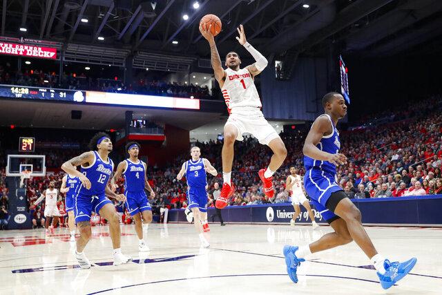 Dayton's Obi Toppin (1) shoots on a break-away as Drake's Roman Penn (12) during the second half of an NCAA college basketball game, Saturday, Dec. 14, 2019, in Dayton, Ohio. (AP Photo/John Minchillo)