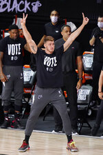 Miami Heat's Meyers Leonard celebrates his teams basket during the second half of an NBA conference final playoff basketball game Sunday, Sept. 27, 2020, in Lake Buena Vista, Fla. (AP Photo/Mark J. Terrill)