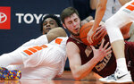 Boston College's Nik Popovic, right, and Syracuse's Oshae Brissett, left, battle for a loose ball during the first half of an NCAA college basketball game in Syracuse, N.Y., Saturday, Feb. 9, 2019. (AP Photo/Nick Lisi)