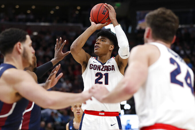 FILE - In this March 21, 2019, file photo, Gonzaga forward Rui Hachimura (21), of Japan, shoots against Fairleigh Dickinson during a first round men's college basketball game in the NCAA Tournament, in Salt Lake City. The NBA Draft is an event that has had an international flavor for years. (AP Photo/Jeff Swinger, File)