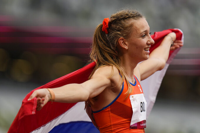 Bronze medalist Femke Bol, of the Netherlands, celebrates after the women's 400-meter hurdles at the 2020 Summer Olympics, Wednesday, Aug. 4, 2021, in Tokyo, Japan. (AP Photo/Petr David Josek)