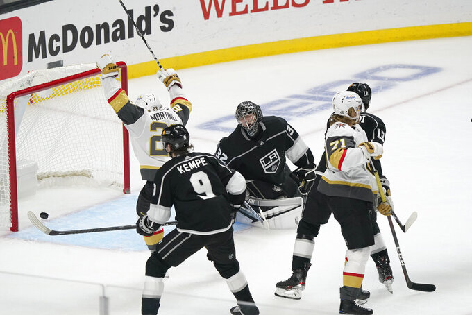 Los Angeles Kings goaltender Jonathan Quick, center, gives up a goal to Vegas Golden Knights center William Karlsson, right front, during the second period of an NHL hockey game Friday, March 19, 2021, in Los Angeles. (AP Photo/Marcio Jose Sanchez)